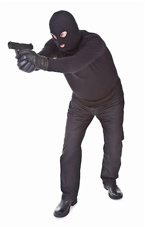robber aiming with his gun isolated on white background Stock Photo - Budget Royalty-Free & Subscription, Code: 400-04358678