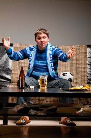 fat man balls - soccer fan is sitting on sofa with beer at home and applauding Stock Photo - Budget Royalty-Free & Subscription, Code: 400-04358884