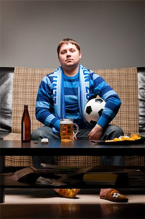fat man balls - soccer fan is sitting on sofa with beer at home Stock Photo - Budget Royalty-Free & Subscription, Code: 400-04358885