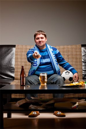 fat man balls - soccer fan is sitting on sofa with beer at home Stock Photo - Budget Royalty-Free & Subscription, Code: 400-04358881
