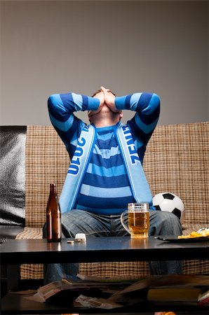 fat man balls - soccer fan is sitting on sofa with beer at home Stock Photo - Budget Royalty-Free & Subscription, Code: 400-04358882
