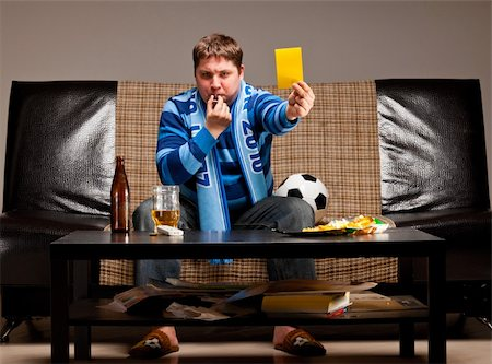 fat man balls - soccer fan is sitting on sofa with beer and showing yellow card at home Stock Photo - Budget Royalty-Free & Subscription, Code: 400-04358883