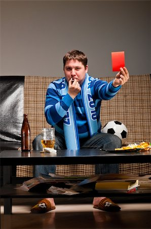 fat man balls - soccer fan is sitting on sofa with beer and showing red card at home Stock Photo - Budget Royalty-Free & Subscription, Code: 400-04358894