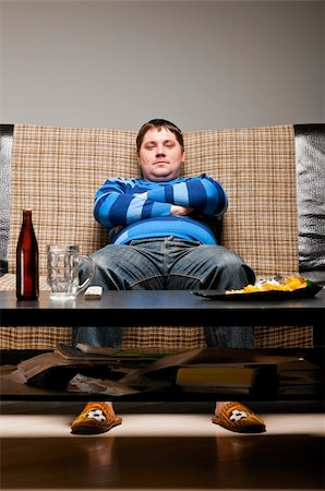 fat man balls - soccer fan is sitting on sofa with beer at home Stock Photo - Budget Royalty-Free & Subscription, Code: 400-04358890
