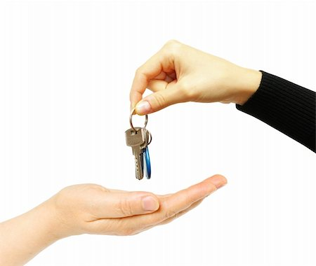 simsearch:400-05936191,k - hand holds a key isolated on white Stock Photo - Budget Royalty-Free & Subscription, Code: 400-04350998