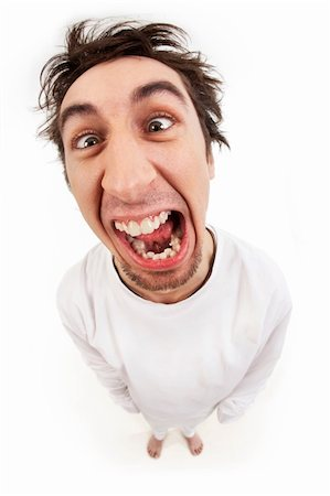 pressmaster - Fish eye shot of screaming insane man in strait-jacket in isolation Stock Photo - Budget Royalty-Free & Subscription, Code: 400-04351476