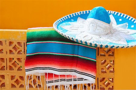 charro mariachi blue mexican hat serape poncho over orange tiles wall Stock Photo - Budget Royalty-Free & Subscription, Code: 400-04352884