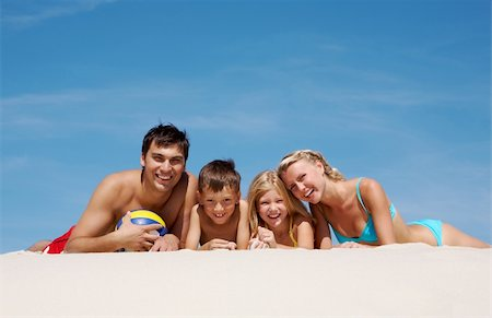 pressmaster - Photo of happy family lying on sand on summer vacation Stock Photo - Budget Royalty-Free & Subscription, Code: 400-04369417