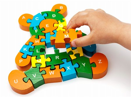 raysay (artist) - solving bear puzzle letters with child's hand copy Stock Photo - Budget Royalty-Free & Subscription, Code: 400-04369856