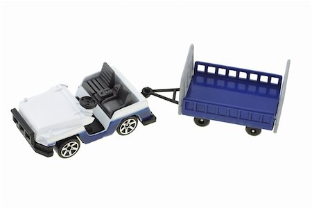 Toy airport baggage transporter and cart on white background Stock Photo - Budget Royalty-Free & Subscription, Code: 400-04360226