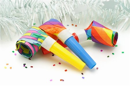 paper blower - Three colorful paper party blowers or nosiemaker Stock Photo - Budget Royalty-Free & Subscription, Code: 400-04360394