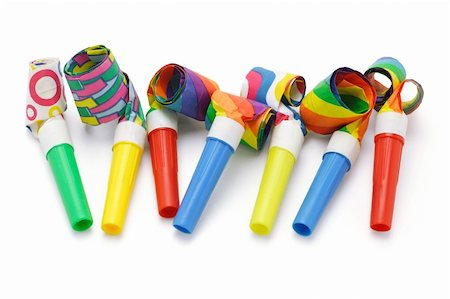 paper blower - Colorful party blowers arranged in a row on white Stock Photo - Budget Royalty-Free & Subscription, Code: 400-04360392