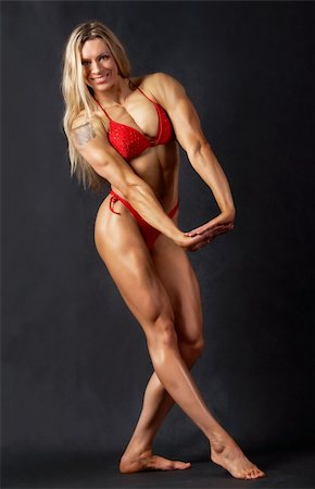 pressmaster - A beautiful woman bodybuilder posing in red bikini and smiling Stock Photo - Budget Royalty-Free & Subscription, Code: 400-04360951