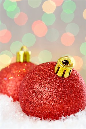 simsearch:400-05749231,k - Red glittering Christmas baubles against glaring background Stock Photo - Budget Royalty-Free & Subscription, Code: 400-04361771