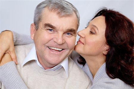 Portrait of middle aged woman embracing happy man while he laughing Stock Photo - Budget Royalty-Free & Subscription, Code: 400-04362001