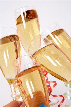 simsearch:400-05749231,k - Close-up of flutes of golden champagne being clinked during toast Stock Photo - Budget Royalty-Free & Subscription, Code: 400-04362131