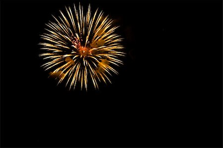 A burst of orange  fireworks against a night sky. Stock Photo - Budget Royalty-Free & Subscription, Code: 400-04362504