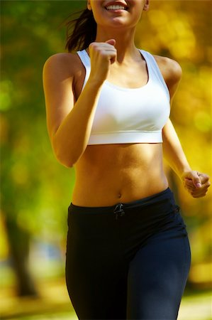 close-up of a young woman jogging Stock Photo - Budget Royalty-Free & Subscription, Code: 400-04363727