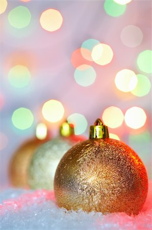 simsearch:400-05749231,k - Golden Christmas baubles on snow against glaring background Stock Photo - Budget Royalty-Free & Subscription, Code: 400-04363813