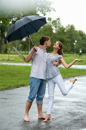 pressmaster - Portrait of woman and man under umbrella during rain Stock Photo - Budget Royalty-Free & Subscription, Code: 400-04374359