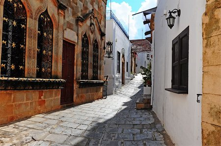 Narrow Alley With Old Buildings In Typical Greek City Stock Photo - Budget Royalty-Free & Subscription, Code: 400-04375112