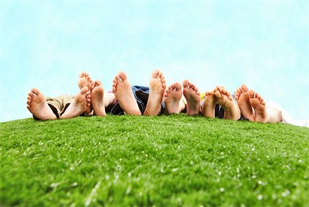Image of several legs lying on the grass and resting Stock Photo - Budget Royalty-Free & Subscription, Code: 400-04376512