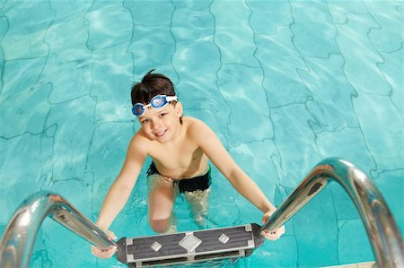 pressmaster - Photo of happy lad in pool smiling at camera Stock Photo - Budget Royalty-Free & Subscription, Code: 400-04379575