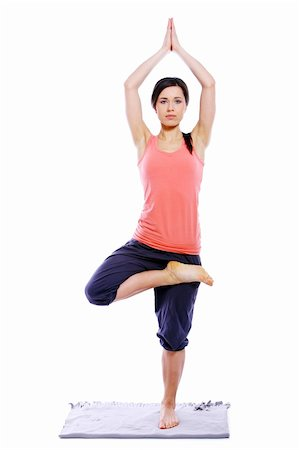 Young and beautiful woman doing yoga exercises Stock Photo - Budget Royalty-Free & Subscription, Code: 400-04379885