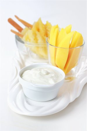 Healthy snack - Pineapple skewer with mango stripes and curd cheese or yogurt Stock Photo - Budget Royalty-Free & Subscription, Code: 400-04370550