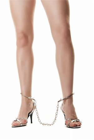 A pair of long handcuffed female legs isolated on white background Stock Photo - Budget Royalty-Free & Subscription, Code: 400-04371516