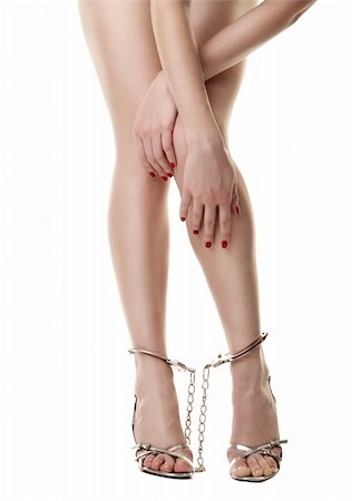 A pair of long handcuffed female legs isolated on white background Stock Photo - Budget Royalty-Free & Subscription, Code: 400-04371517