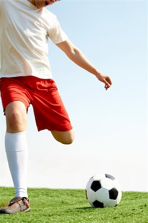 Portrait of a soccer player with ball on football field Stock Photo - Budget Royalty-Free & Subscription, Code: 400-04373433