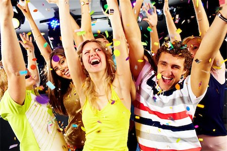 Photo of excited teenagers raising their arms in joy Stock Photo - Budget Royalty-Free & Subscription, Code: 400-04373773