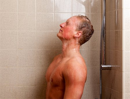 Torso of a man showering with head back, water on face Stock Photo - Budget Royalty-Free & Subscription, Code: 400-04384639