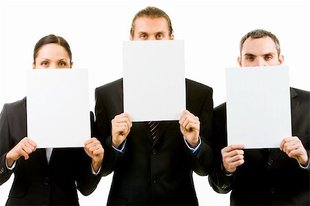 Row of three business partners holding blank papers by faces Stock Photo - Budget Royalty-Free & Subscription, Code: 400-04387096