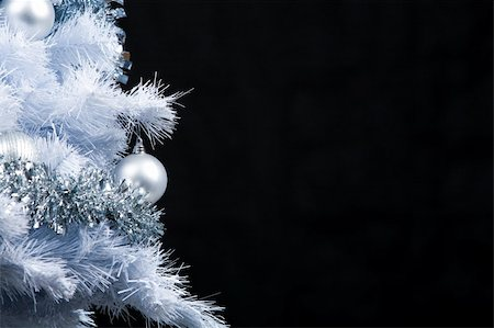 simsearch:400-05749231,k - Part of festive New Year tree decorated with silver garlands and toy balls over black background Stock Photo - Budget Royalty-Free & Subscription, Code: 400-04387190
