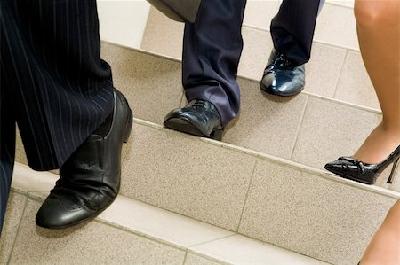 stocking feet - Image of female and male legs going downstairs Stock Photo - Budget Royalty-Free & Subscription, Code: 400-04387383