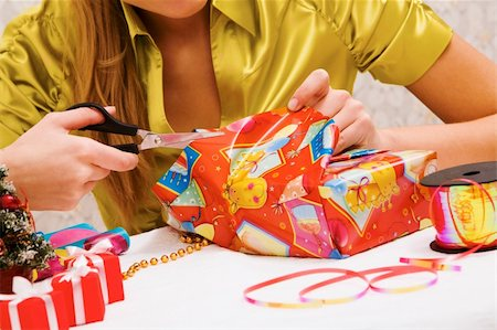 simsearch:400-05749231,k - Close-up of female hands wrapping Christmas presents Stock Photo - Budget Royalty-Free & Subscription, Code: 400-04388239