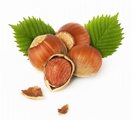 hazelnuts with leaves on white background Stock Photo - Budget Royalty-Free & Subscription, Code: 400-04382503