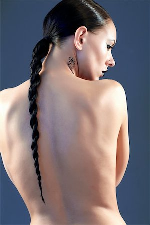 Back of naked woman with pigtail posing before camera Stock Photo - Budget Royalty-Free & Subscription, Code: 400-04395246