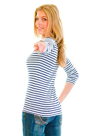 Smiling beautiful teen girl looking back and pointing finger at you isolated on white Stock Photo - Budget Royalty-Free & Subscription, Code: 400-04397974