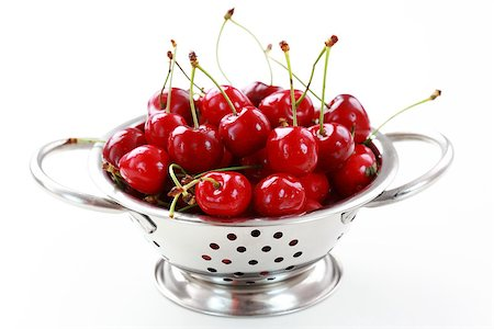 Fresh cherries in the bowl on white background Stock Photo - Budget Royalty-Free & Subscription, Code: 400-04398367