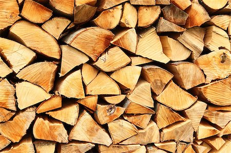 Pile of chopped fire wood prepared for winter Stock Photo - Budget Royalty-Free & Subscription, Code: 400-04398674