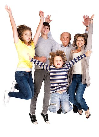 Jumping family having fun, enjoying indoors. Stock Photo - Budget Royalty-Free & Subscription, Code: 400-04398998