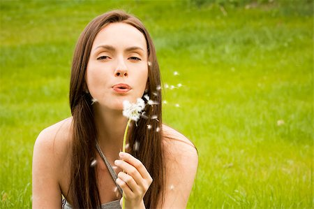 Girl with dandelion on green field Stock Photo - Budget Royalty-Free & Subscription, Code: 400-04399510