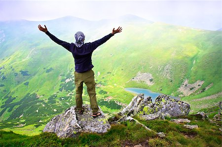 Beautiful mountains landscape with lake  in Carpathian mountains and man on the top Stock Photo - Budget Royalty-Free & Subscription, Code: 400-04399538