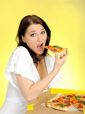 fat italian woman - Pretty young casual brunette girl eating tasty pizza Stock Photo - Budget Royalty-Free & Subscription, Code: 400-04390892