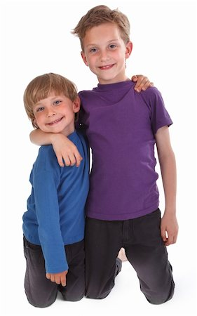two happy brothers against white background Stock Photo - Budget Royalty-Free & Subscription, Code: 400-04391209