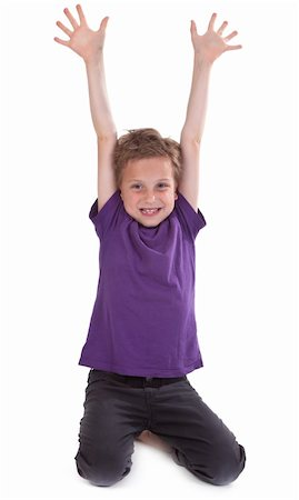 happy young boy with hands raised against white background Stock Photo - Budget Royalty-Free & Subscription, Code: 400-04391200