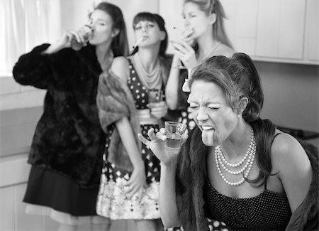 Woman reacts to strong alcohol while friends smoke and drink in the kitchen Stock Photo - Budget Royalty-Free & Subscription, Code: 400-04391485
